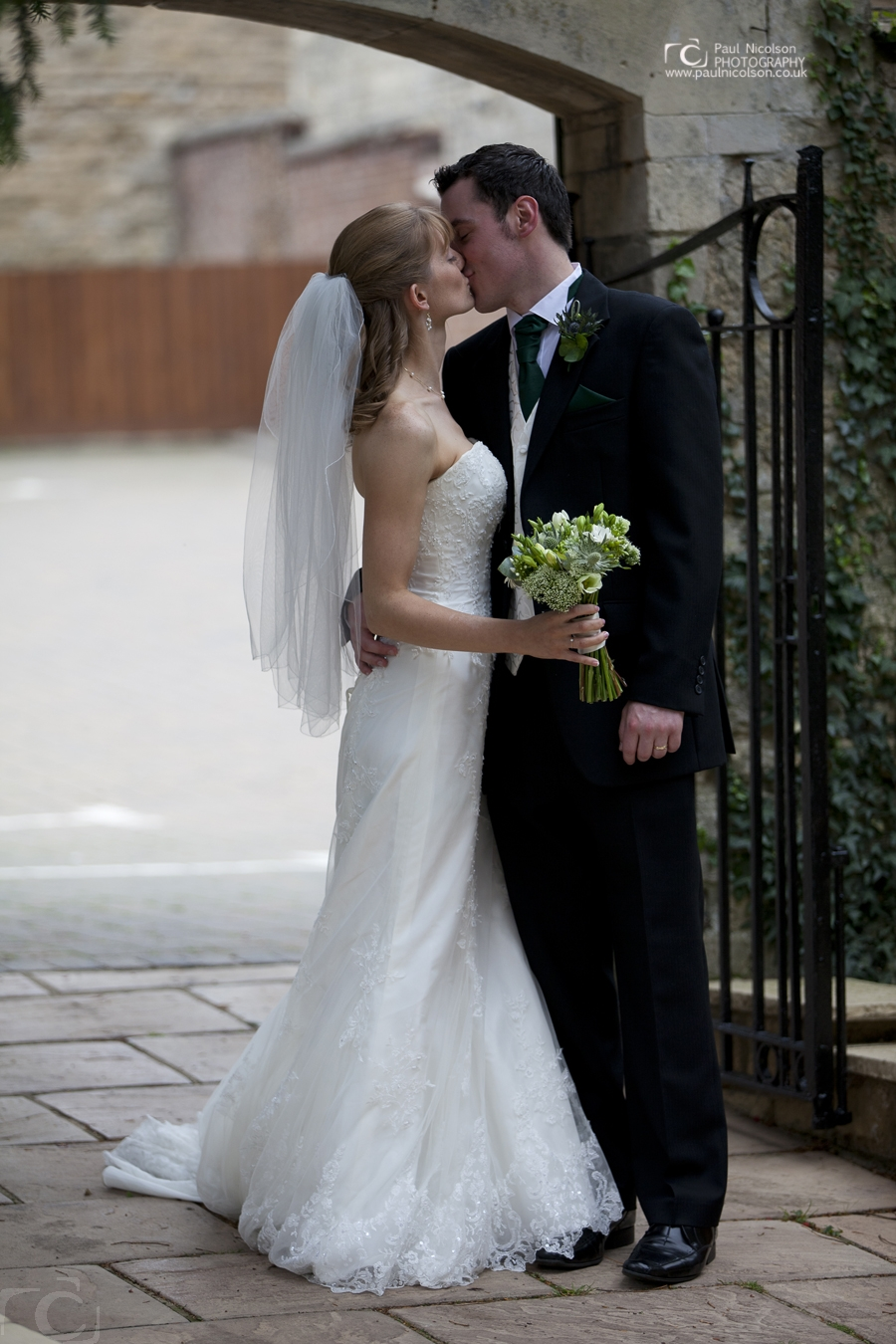 Bride and Groom Wedding Kiss at The george Hotel Gardens Stamford george hotel weddings