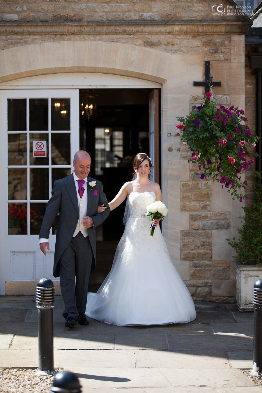 Bride and father Haycock hotel, courtyard.