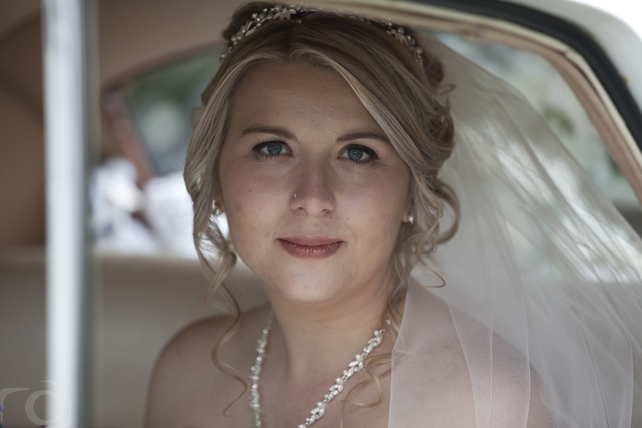Holly arriving in the wedding car at the Bell Inn Hotel Stilton Peterborough